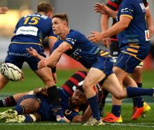 Kayne Hammington clears the ball for Otago during its win over Canterbury at Forsyth Barr Stadium...