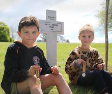 Rio (9) and Liv (7) Pringle helped plant the new memorial oak tree for their great-great-great...