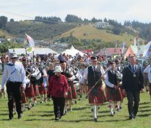 Waitaki district Mayor Gary Kircher (right) helps lead the grand parade at the North Otago A&P ...
