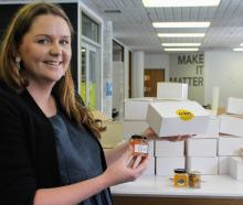 Coin South chief activator Louise Evans prepares the first batch of Southland tasting boxes,...