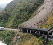 A truck was trapped inside the rock shelter in the Otira Gorge on State Highway 73 as a rockfall...