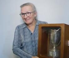 Former England international Gill Burns with the recovered trophy. Photo: England Rugby