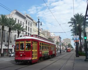 Streetcars travel down New Orleans' bustling Canal St. Photos: Pam Jones.