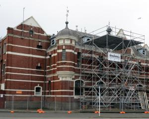 The former Dunedin prison yesterday, where workers were erecting scaffolding as part of an effort to restore the building to its original 1896 appearance. Photos by Linda Robertson.
