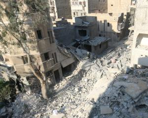 A general view shows the site of the air strike in which Omran Daqneesh was injured. The Daqneesh family lived in the building on the left. Photos from Reuters.