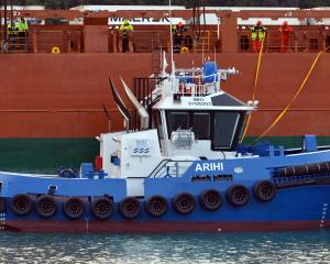 Port Otago's new tug Arihi being  unloaded from the heavy lift cargo ship MV Deltagracht at Port...