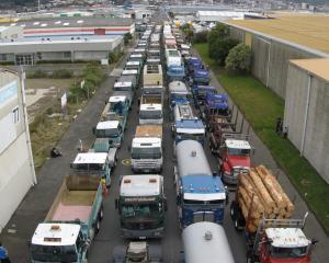 Trucks park in Otaki St for the start of the Special Rigs for Special Kids yesterday. Photo: Bert...