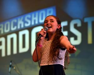 Longford Intermediate pupil and The Royals band member Ella McDowall (11), of Gore, sings during...