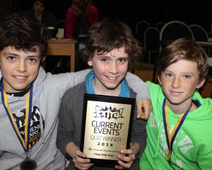 Arrowtown Primary pupils Tobin Wilson (13, left), Ollie Mclean (13) and Finley Husheer (12) are stoked to win the years 7 and 8 section of the Otago Daily Times Extra! current affairs quiz at Cromwell College last night. Photos by Jono Edwards.