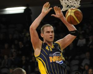 Allred in his Otago Nuggets playing days, going up for a shot against the Waikato Pistons in a...