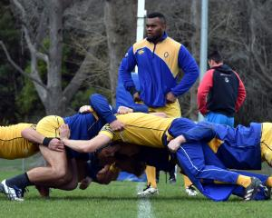 Otago loose forwards Naulia Dawai (centre) and Lee Allan (left) watch some Otago forwards going...