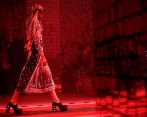 A models shows one of Gucci's 'fantasy' designs at Milan Fashion Week. Photo: Reuters.
