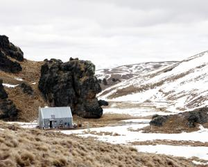 Meadow Hut nestles by a particularly expressive rock outcrop. PHOTO: LAUREN RIMMER