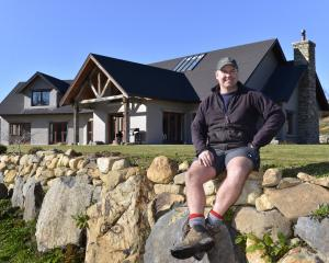 Sacha Gray outside the house he built for himself, his wife Emily and their three daughters: ''I...