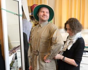 Costume designer Maryanne Wright-Smyth adjusts the costume of Will Spicer as Lord Edgar on Safari in Egypt. Photos by Linda Robertson.