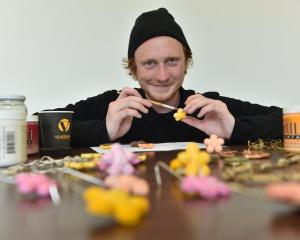 Otago Polytechnic Art School graduating student Brogan Nuttall works on one of his ''meat'' jewellery flowers. Photos by Peter McIntosh.