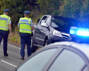 A Dunedin man is arrested following a road rage incident in Portobello Rd yesterday. Photos by Stephen Jaquiery.