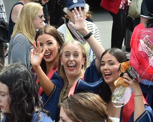 Enjoying themselves during the polytech graduation parade along George St yesterday are (from...