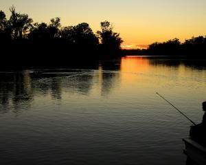 A fisherman greets the dawn at Caudo Vineyard. PHOTOS: FERGUS BLAKISTON
