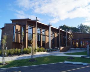 Tamariki play at Te Uru Taumatua, Tuhoe's headquarters near Whakatane, which runs off solar power...