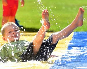 "Oliver McKague (4), of Dunedin, revels in the ""slide"". Photos: Peter McIntosh."