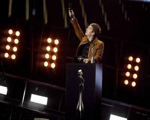 "Noel Gallagher gestures as presents Brit Award for British Album of the Year to David Bowie's ""Blackstar"". Photo: Reuters"
