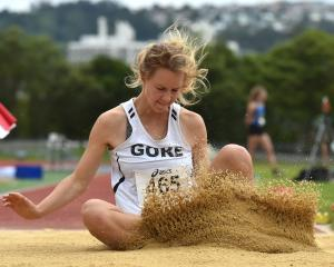 Emma Hopcroft, of Gore, lands during the women's under-20 long jump.  Photos: Gregor Richardson.