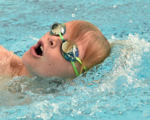 Harry Hawken (10), of St Clair School, in action during the swim leg. Photos by Peter McIntosh.