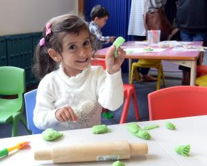 Nagham Al-Aashoor (3) enjoys playing at baking during the opening of the new Wild Things Kotuku...