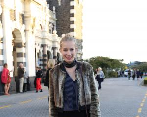 Jessica-Belle wears jacket by Kate Sylvester, Lucy Mitchell top, pants by Turet Knuefermann,...