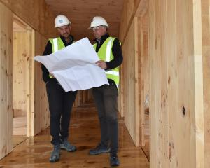 Naylor Love project manager Cameron Orr (left) and operations manager Jason Tutty look at plans...