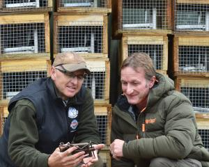 Yellow-eyed Penguin Trust field manager David McFarlane (left) and New Zealand Deerstalkers' Association Otago branch senior vice-president Greg Fagg inspect a mark 6 Fenn trap. Photos by Peter McIntosh.