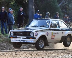 Tony Gosling and Blair Read fly out of a dry ford at Whare Flat in their Ford Escort during the classic car section of Rally Otago. Photo by Stephen Jaquiery.