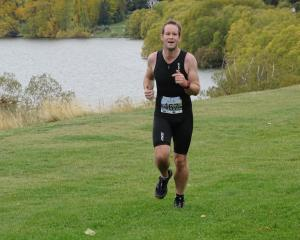 Matt Jackson, of Christchurch, nears the finish line of the 2017 Lake Hayes Easter Triathlon —...