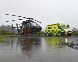 Emergency services staff transfer a patient from the Otago Regional Rescue Helicopter to an...