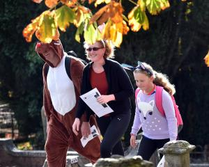 Steve, Tracey and Lily (8) Havard leave the Southern Cemetery. Photos: Peter McIntosh.