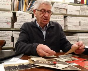 Ensuring future generations know about World War 1, Ken Allan, of Wanaka, sorts  and labels  old...