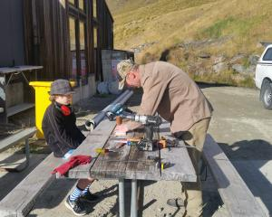 Kea advocate Paul van Klink with the assistance of Luka van Maren (12) prepare signs to be...