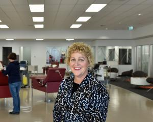 Ali Keast, of New Zealand Blood Service, oversees the setting up of equipment at the Dunedin Blood Donor Centre's new premises. Photo: Peter McIntosh.