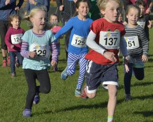 Front runner Connor Horne leads the year 1 and 2 pupils' race. Also pictured are (from left) Talia Hargraeves, Elodie Brown, Peta Richardson and Lotta Schwefel. Photos: Gerard O'Brien.