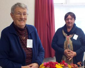 Shirley Admiraal (left) presents her version of Autumn Fire to assessor Christine Pickard. Photos...