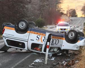 A ute lies upside down in Three Mile Hill Rd, Dunedin. Photo: Stephen Jaquiery