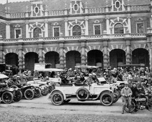 Motorists assemble outside the Dunedin Railway Station for the opening run of the Otago Motor...