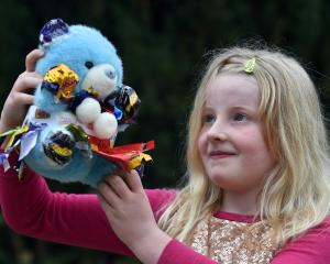Breana Geddes-Pringle (8), of Oamaru, shows off her teddy, Miss Cadbury. Photos: Peter McIntosh.