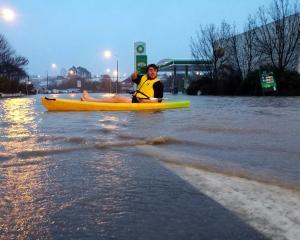 Daniel de Garnham, of Timaru, makes use of his kayak on State Highway 1, near BP, Showgrounds,...