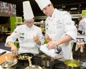 Otago Polytechnic Central Campus chefs Freda Zhang (left) and Sam Farr cook their way to a silver medal in this year's national Nestle Toque d'Or student culinary competition. Photos: Supplied