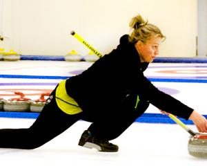Bridget Becker heads towards a win with her brother Sean in the New Zealand Curling Association's...