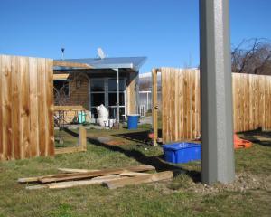 A fence broken when a power pole fell on to an Alexandra property on Sunday night awaits repair. Photo: Pam Jones