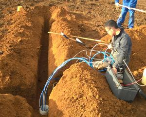 A Plant and Food researcher installs a flux meter as part of the Foundation for Arable Research nutrient-loss data-collection project. Photos: Supplied