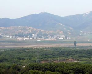 Gazing through the haze towards one of North Korea's border villages from the safety of South...